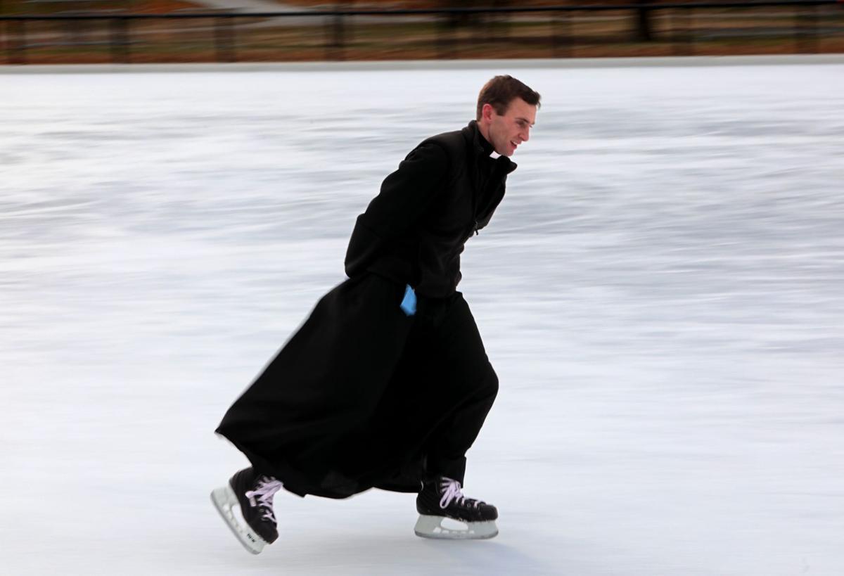 Skating priest enlightens flock