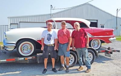 Decked out in Alcan White over Festival Red, this '56 Olds Holiday Sedan will soon be cruisin' in style! Left-to-right, Randy Gower, proud owner of the Olds; Phil Carrico, good friend and the one who found the Olds for sale in St. Charles and Bob Murphy, upholsterer extraordinaire who installed the headliner.