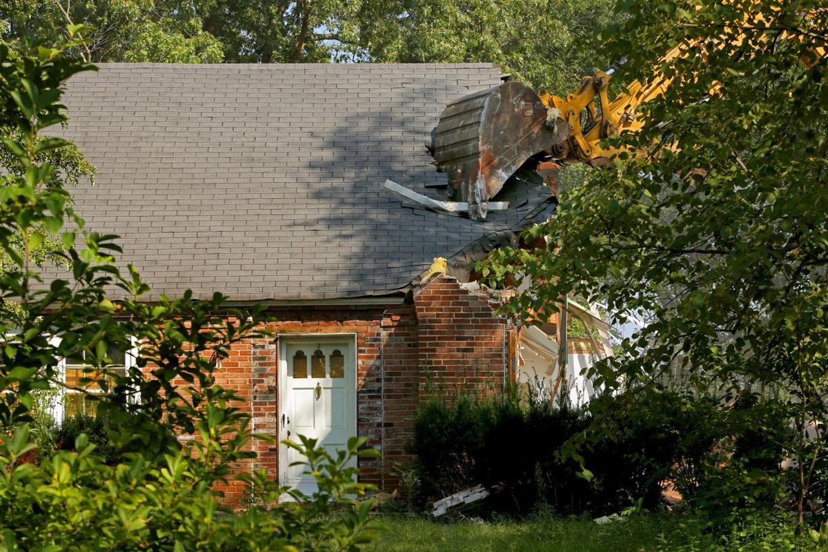 Demolition continues on homes purchased by St. Louis County library