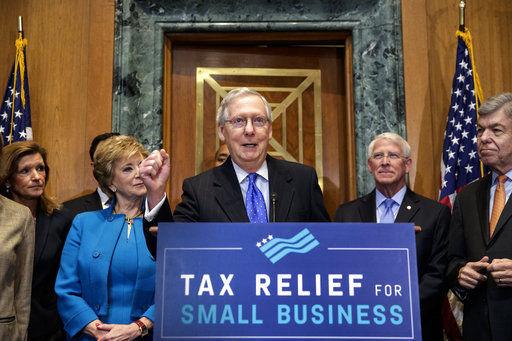 The Latest: GOP Sen. Johnson still withholding on tax bill