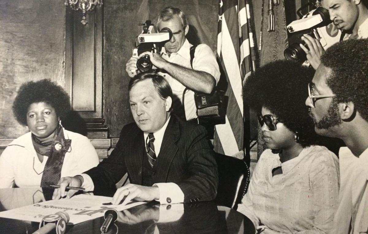 Mayor James F. Conway announces award of two homes for $1 in 1978
