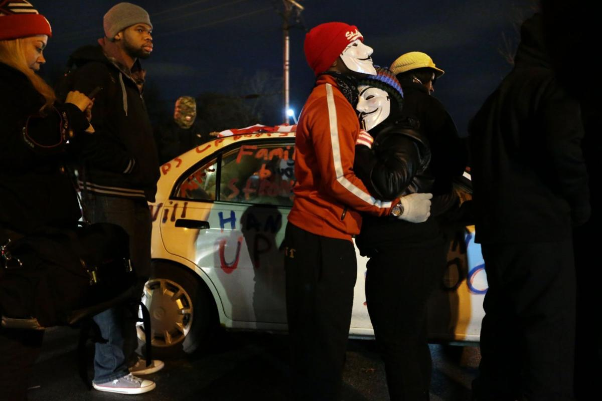 Protesters at Ferguson police station, awaiting grand jury decision