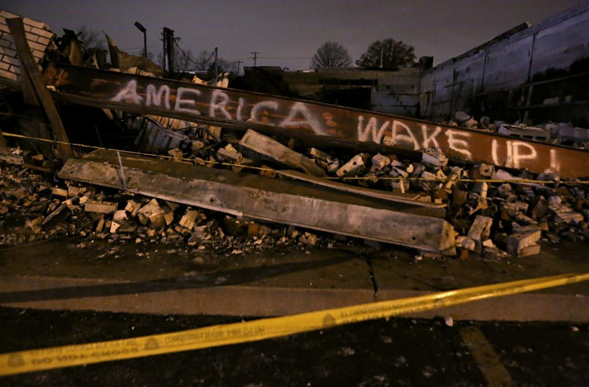 Ferguson graffiti on burned down Beauty Town