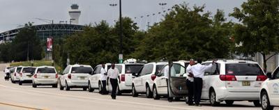 Cab companies accuse Lambert of turning a 'blind eye' to UberX