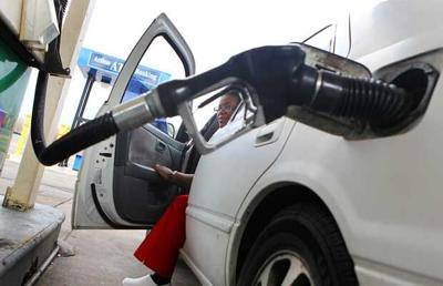 Woman waits for gas pump in St. Louis