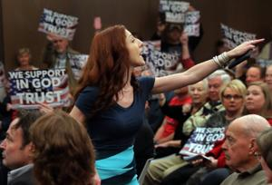 ACLU sues Wentzville council over removal of activist who opposed 'In God We Trust' sign