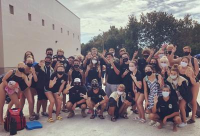 Mitchell boys, girls swim teams win conference