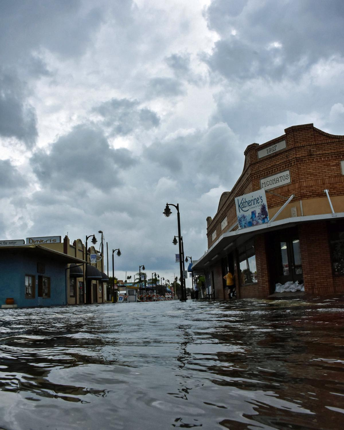 Tidal flooding again closes Sponge Docks main street ...