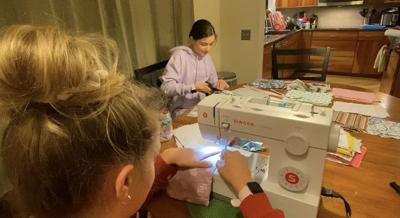 Killing time by helping to save lives: Palm Harbor sisters have made hundreds of masks during the COVID-19 quarantine