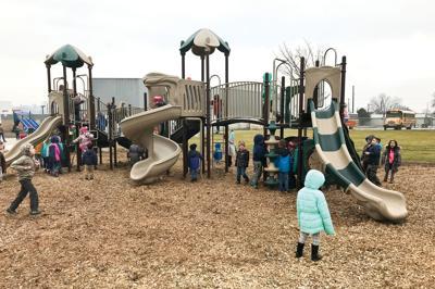 School alumni install new playground unit