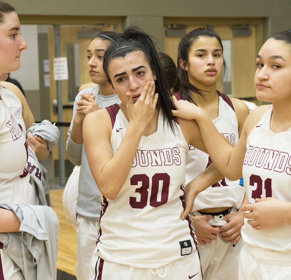 Lady 'Hounds play as champs in regional loss