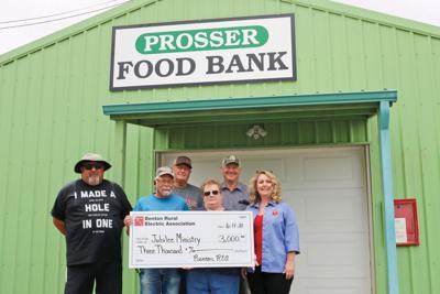 Benton REA donates $15K to local food banks