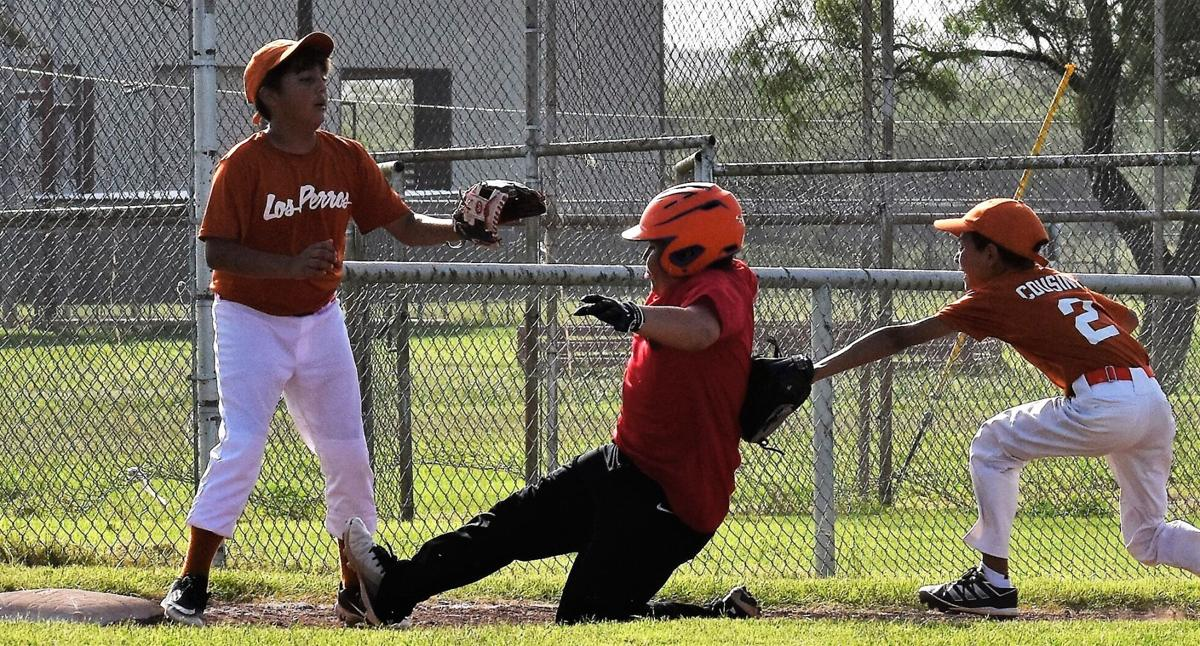 Camdyn Soto tagged out by Derek Bewley with Keian Martinez waiting to help on third.jpg
