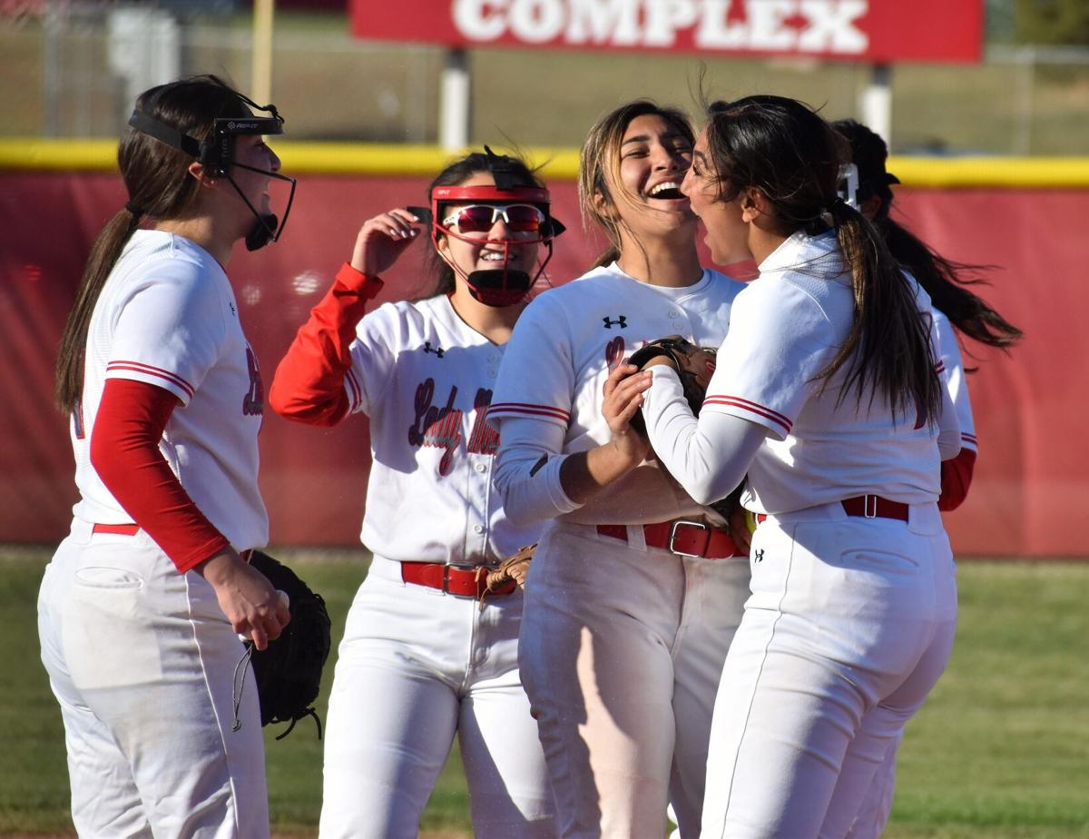 Ellianna Jazzy Victoria and Jenika Celebrating after last out.jpg