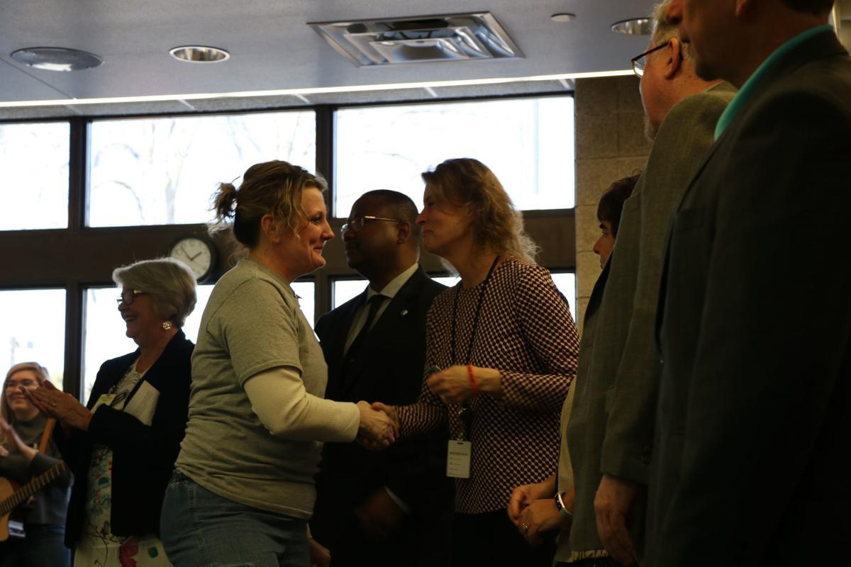 Shakopee womens prison warden Tracy Beltz congratulates prisoner