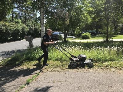 Orono  PD mowing lawn