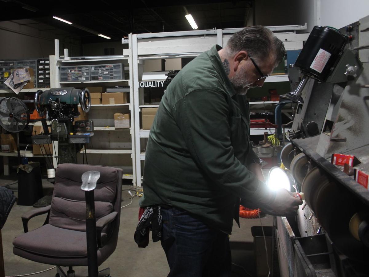 Pomazi works in his workshop
