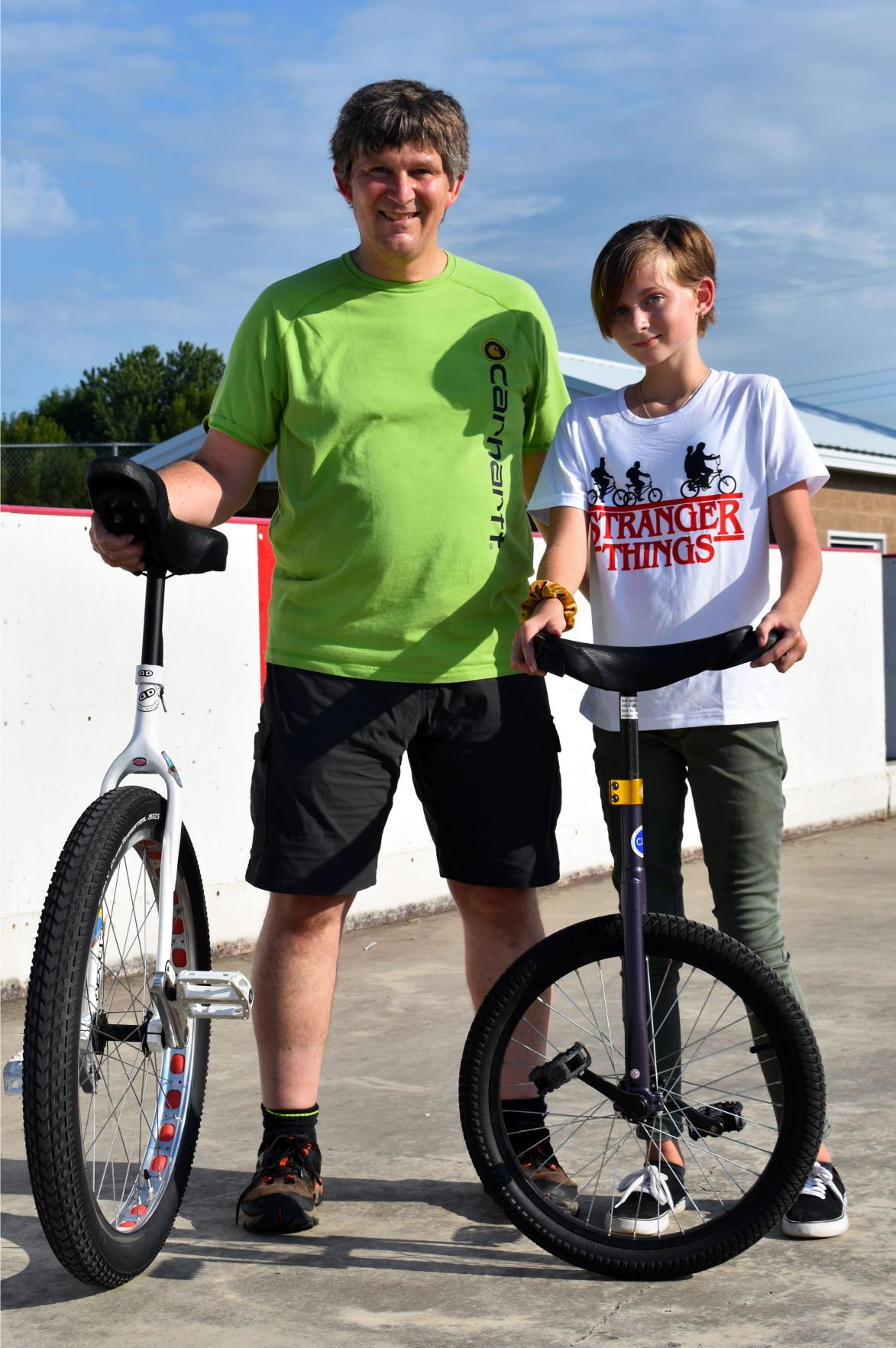 Unicycling duo