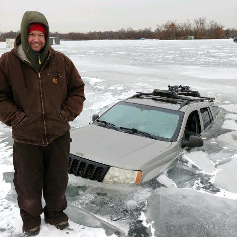 Chet Johnson in front of Jeep in ice