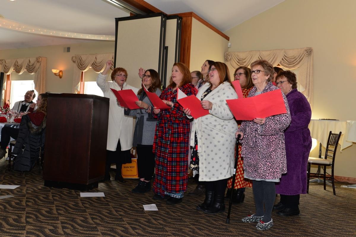 """Jordaness Lions singing """"The 12 days of Christmas"""" in bathrobes"""
