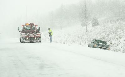Vehicle towed out of the ditch in a winter storm