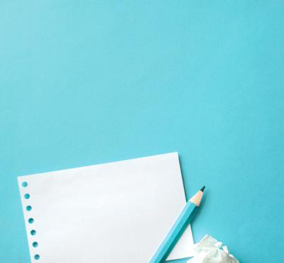 Letter to editor stock photo blue paper and pen