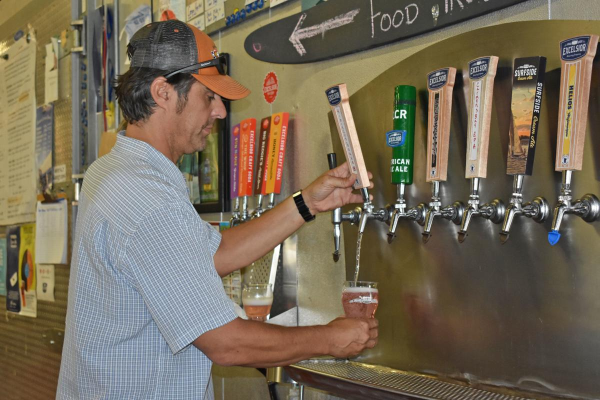 Excelsior Brewing Company - John Klick pouring seltzer