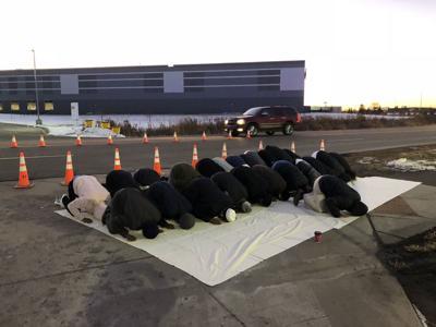 Shakopee Amazon protest - men praying