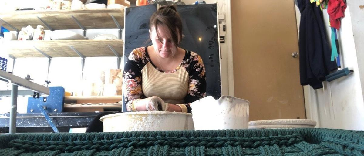 Maggie Stanwood doing pottery