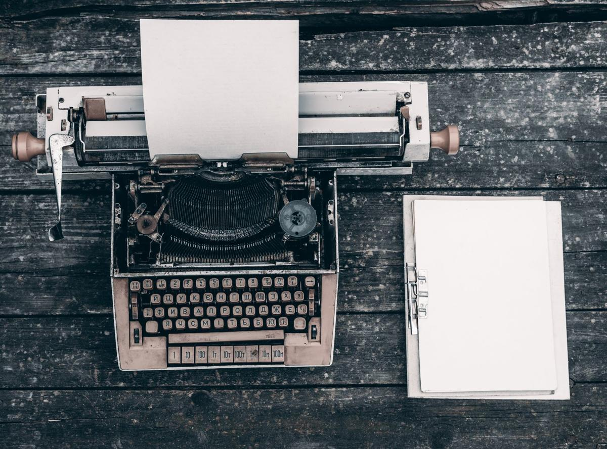 letter to editor stock art typewriter and notebook