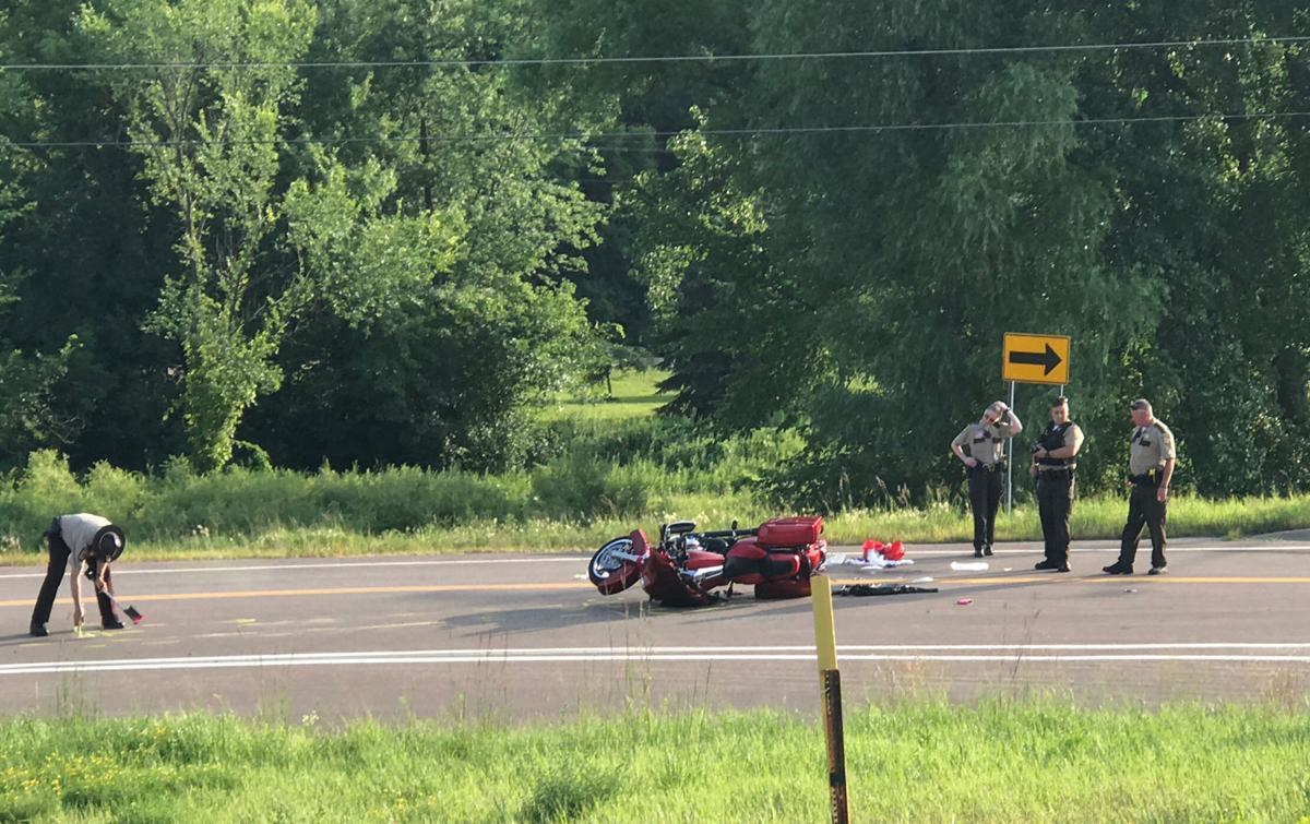 Woman transported to hospital after motorcycle accident in