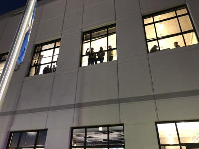 Workers look out windows at Shakopee Amazon (copy)