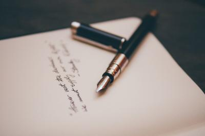 letter to editor stock art fancy pen and paper
