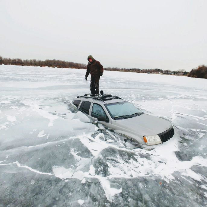 Standing on roof of submerged Jeep