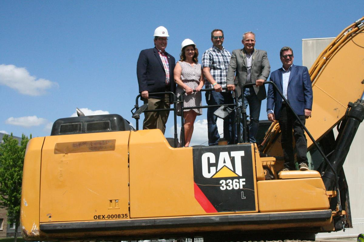 Board of Commissioners on excavator