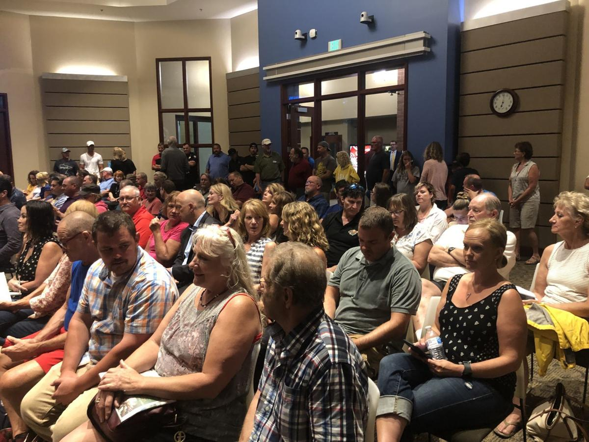 A crowded city hall awaits the Spring Lake Ridge presentation