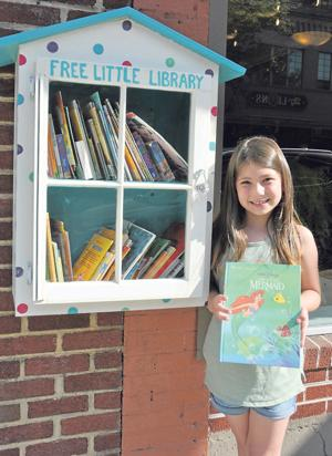 Marion girl creates little library for the love of reading