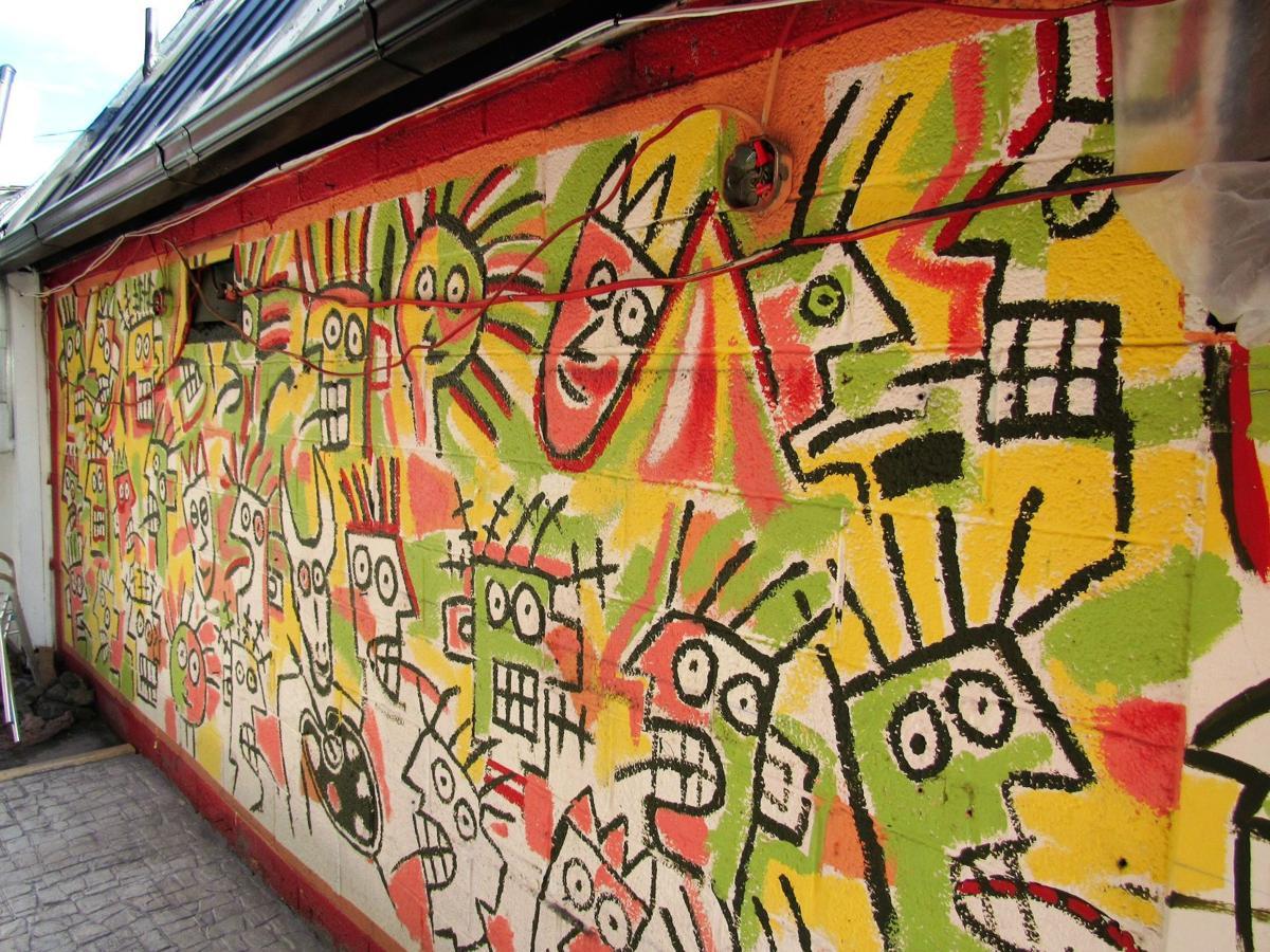 New restaurant owner is bringing beloved Starving Artist mural back ...