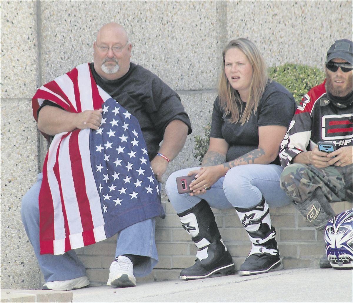 Man wearing flag