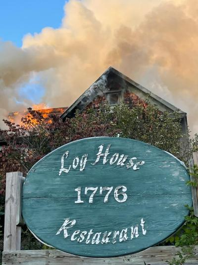 Log House fire with sign