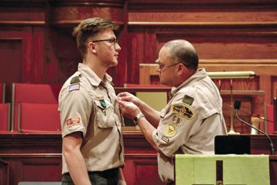 Burgess gets Eagle Scout pin