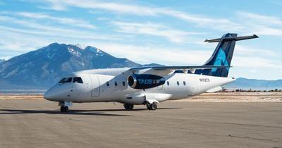 Taos Air jet parked at Taos Regional Airport.