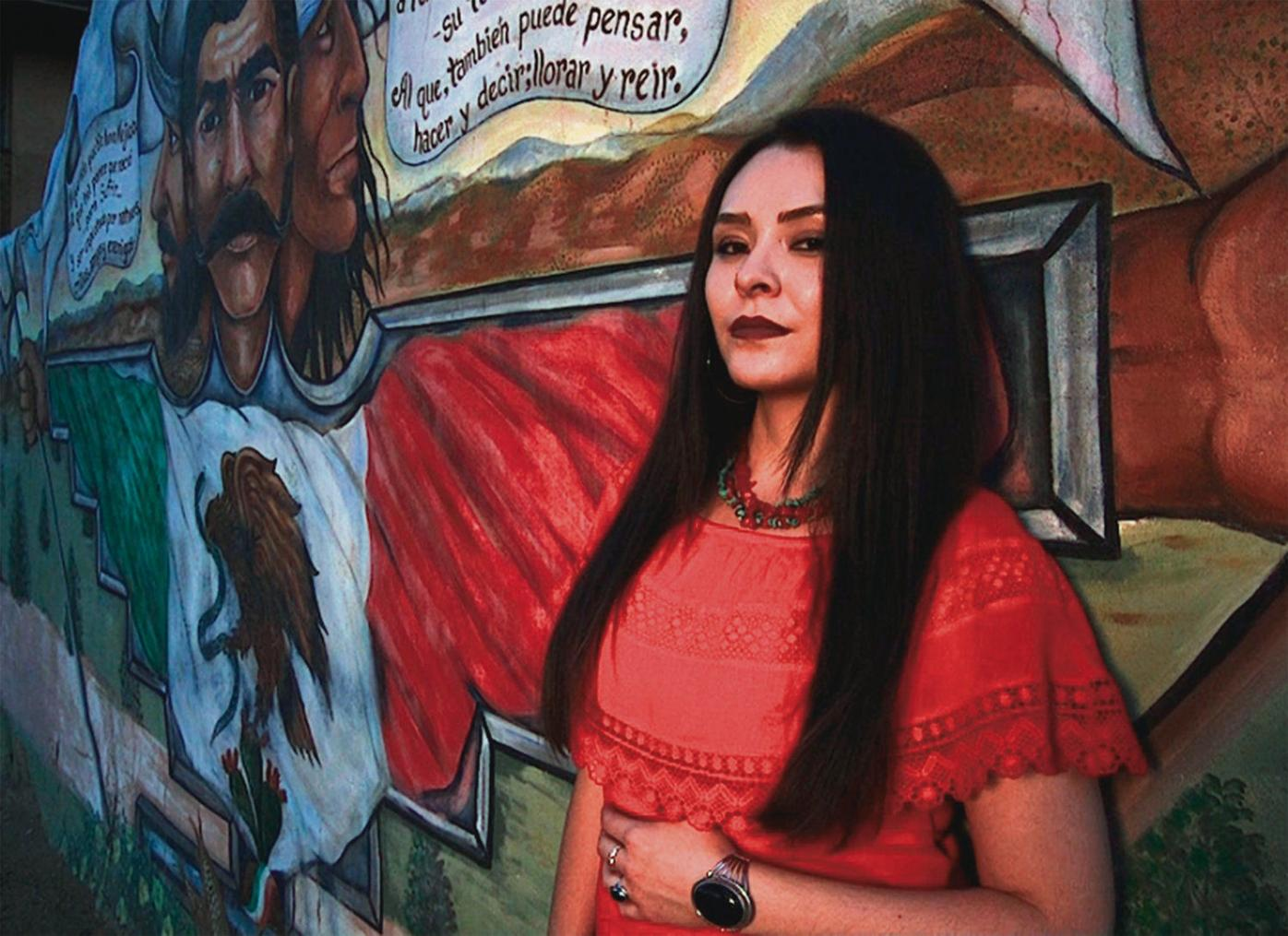 Poet Olivia Romo sings to the acequias