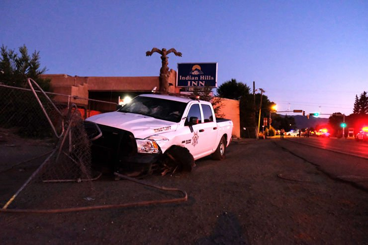 Truck rolls after crash with Taos County Sheriff's Office vehicle near Smith's.