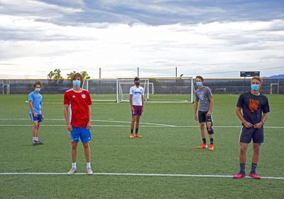 Taos football and soccer athletes
