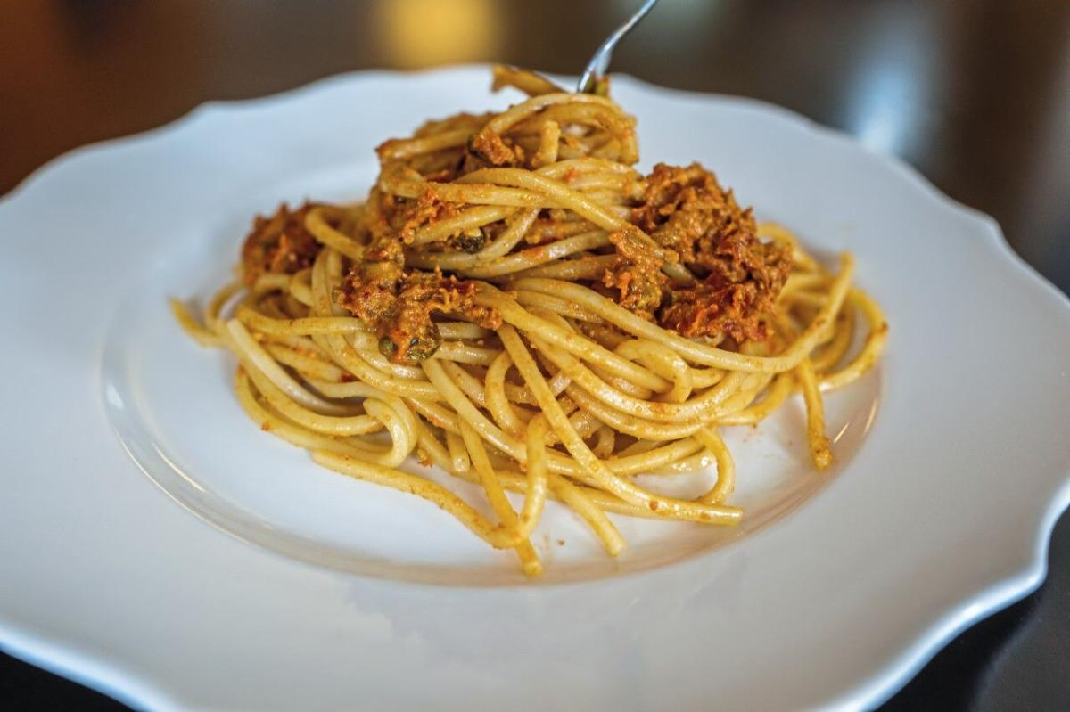 Spaghetti served with piquant sun-dried tomatoes and pistachio pesto.