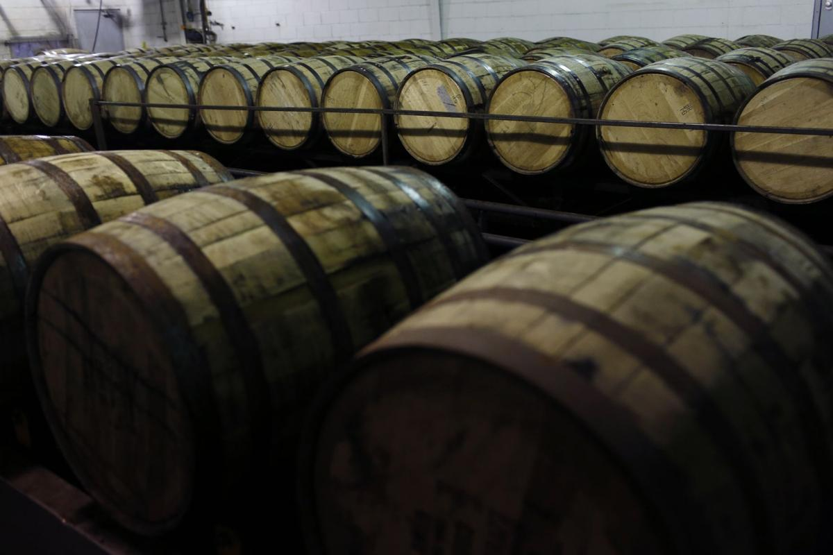 In this file image from 2014 barrles of Jim Beam Bourbon wait to be drained at the Jim Beam Bourbon Distillery in Clermont, Kentucky.