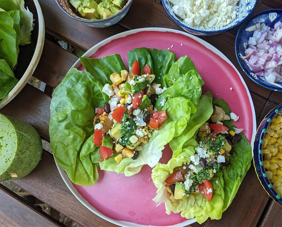 Chicken taco lettuce cups are a hand-held take on the popular Mexican 7- layer dip served at parties.