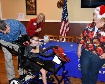 Gift of adaptive trike to disabled Palm Harbor boy brings family to tears