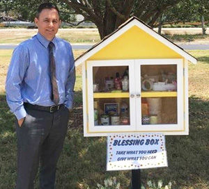 Local woman installs donation box in front of Seminole